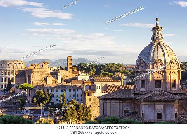 Santi Luca e Martina Church with Coliseum and in background. Rome, Italy