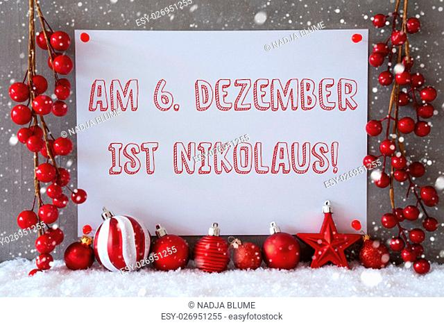 Label With German Text Am 6. Dezember Ist Nikolaus Means December 6th Is Nicholas Day. Red Christmas Decoration Like Balls On Snow