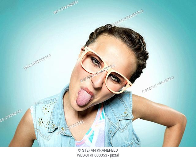 Young woman sticking out her tongue
