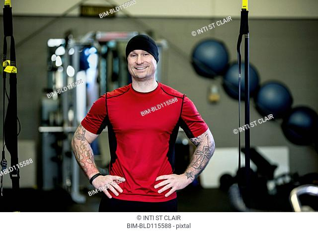 Caucasian man smiling in gym