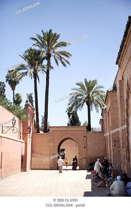 Group of people outside Koutoubia Mosque, off Jamaa el Fna Square, Marrakech, Morocco