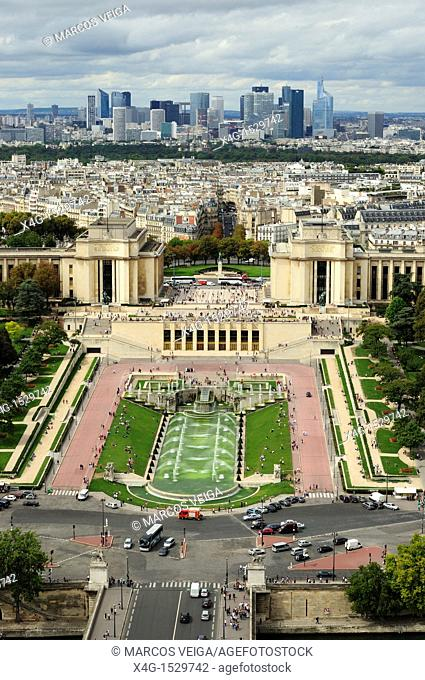 Gardens and esplanade du Trocadéro with the modern buildings of La Defense on the background  Paris, France