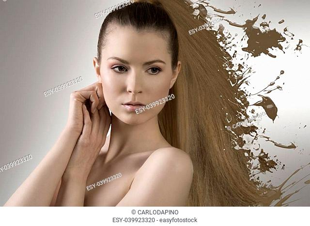 beauty woman in close-up portrait with long smooth blonde hair melting in paint