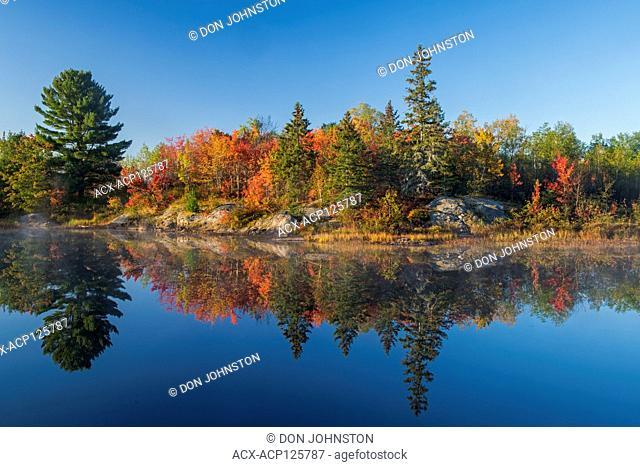 Autumn reflections in Fairbank Creek, Greater Sudbury (Walden), Ontario, Canada