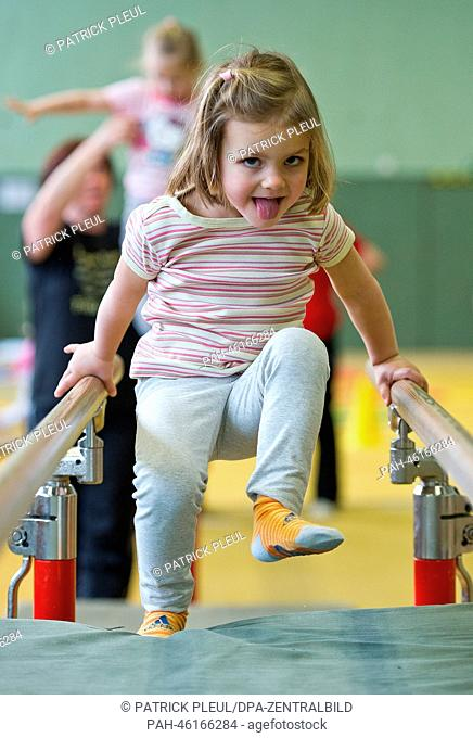 Three-year old Mia from Matroschka Kindergarten plays on the parallel bars in Frankfurt Oder, Germany, 30 January 2014. Once a week the three to five year old...