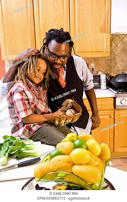 African American father and young son in kitchen