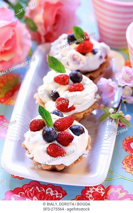 Wild strawberry and blueberry cream tarts