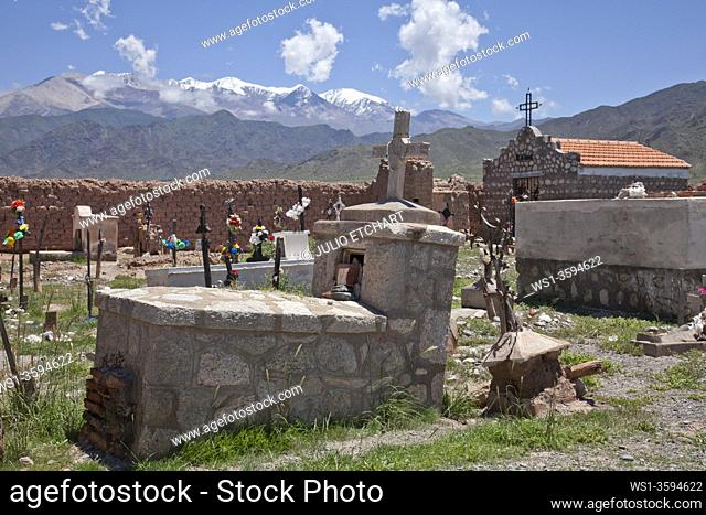 Cemetery with crosses with Nevado Cachi snowcapped mountain range in Andes region, Salta, Argentina