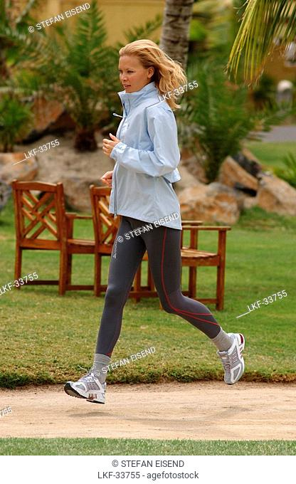 A woman jogging, running on Mauritius, Fitness, MR