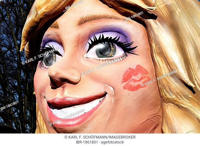 Radiant face of a blond woman with a lipstick imprint on her cheek, paper-mache figure, parade float at the Rosenmontagszug Carnival Parade 2011, Duesseldorf