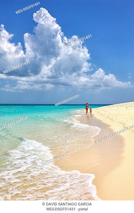 Tanzania, Zanzibar Island, Unguja, Niamembe Island, mother and little daughter strolling on the beach