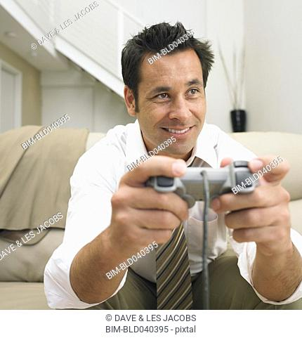 Businessman playing video games