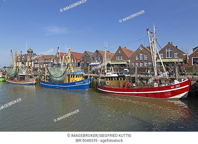 Colourful shrimp boats in the fishing port, Neuharlingersiel, East Frisia, Niedersachsen, Germany, Europe