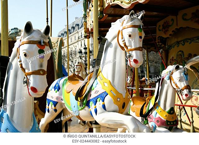 detail of white horses and carriage in a carousel, roundabout or merry-go-round retro style