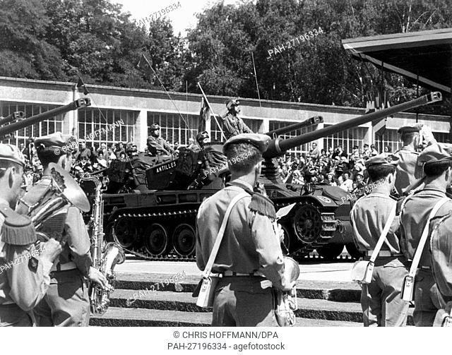 In the headquarters of the French army in Berlin, the quarter Napoleon, tanks pass the guests and the military band during a parade on the occasion of the...