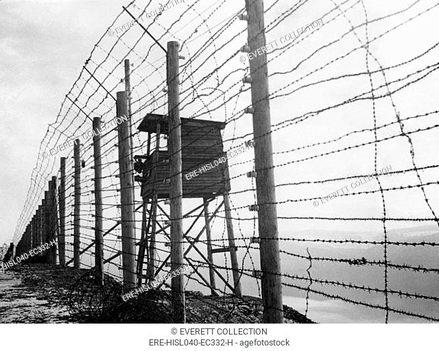 Electrified barbed wire fence and guard house at Struthof Concentration Camp near Natzweiler, France. The evacuated camp was discovered by the American Army