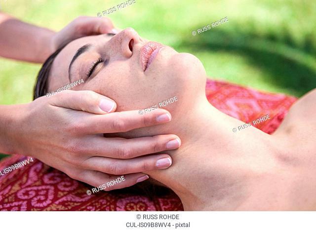 Woman in spa environment, having facial treatment