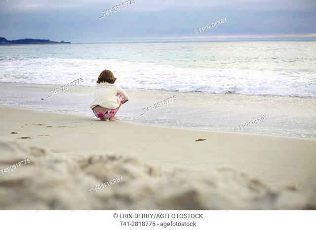 A girl at the beach in the summer