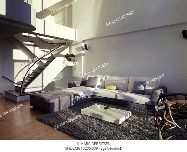 Living room in modern home with sectional sofa and hardwood floor