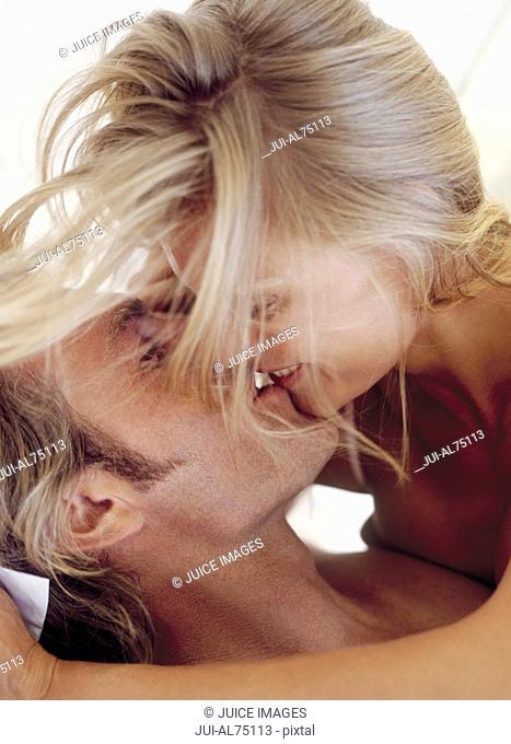 View of a woman kissing her boyfriend