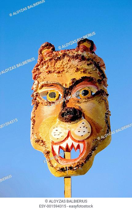 Mardi Gras lion mask on sky background
