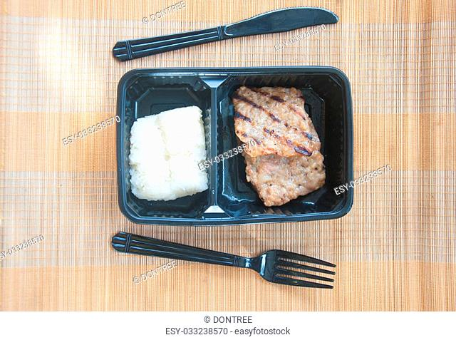 grilled pork served with sticky rice in black box