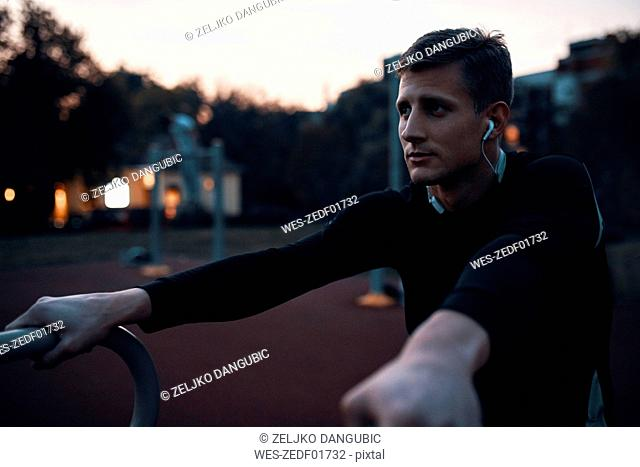 Portrait of sportive man outdoors in the evening