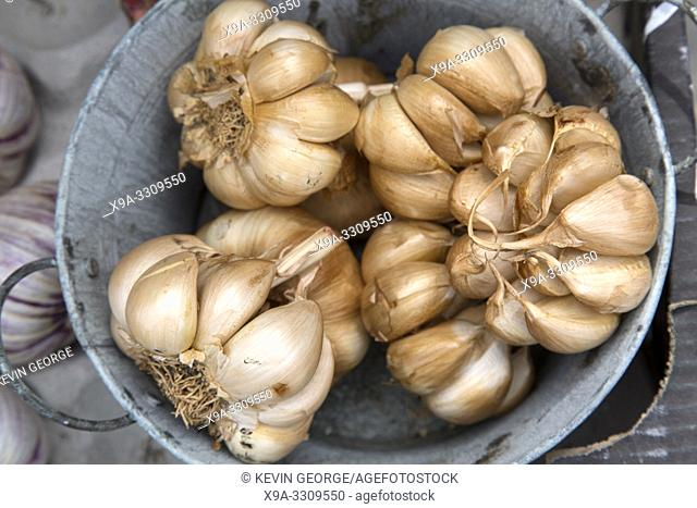 Brown Dried Garlic on Market Stall