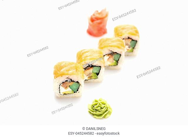 Fresh and appetizing sushi rolls with an eel avocado and Philadelphia cheese wrapped in salmon. Isolated. Sushi roll on a white background