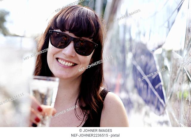 Smiling woman holding drink