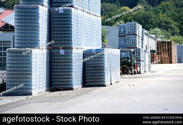 05 August 2020, Mamming: Stacked pallets and barrels are standing on the premises of a cannery where employees have been infected with the coronavirus