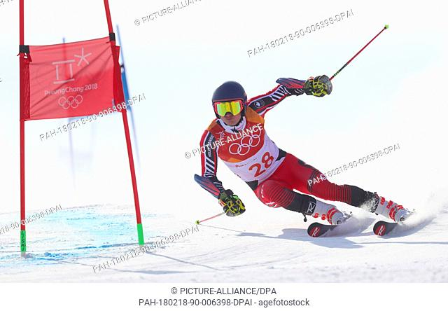 18 February 2018, South Korea, Pyeongchang, Olympics, Alpine Skiing, Giant slalom, men, 1st heat, Yongpyong Alpine centre: Trevor Philp of Canada in action