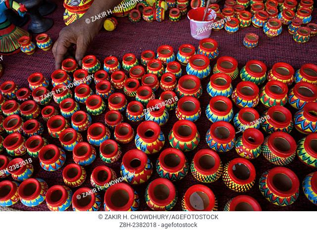 A potter painting clay toys in Dhaka