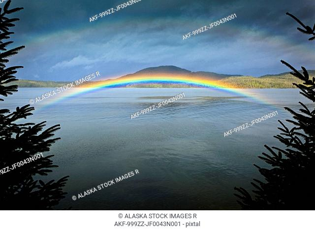 Low arching rainbow over the waters of Clover Passage, Ketchikan, Southeast Alaska, Spring