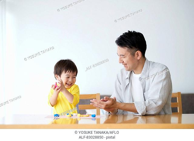 Japanese father and kid playing