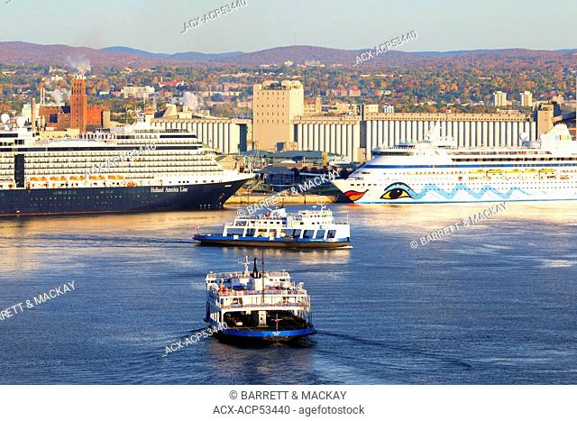 Car ferries crossing the St. Lawrence River in front of cruise ship docked at Quebec City, Quebec, Canada