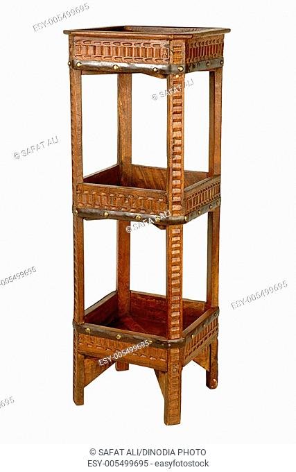 Brass and iron design fitting on antique wooden telephone and magazine stand ; Jodhpur ; Rajasthan ; India