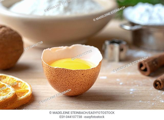 Fresh egg and other ingredients for Christmas baking