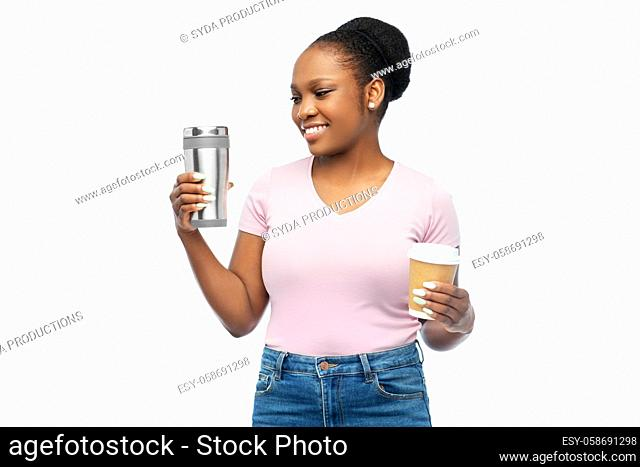 woman with coffee cup and tumbler for hot drinks