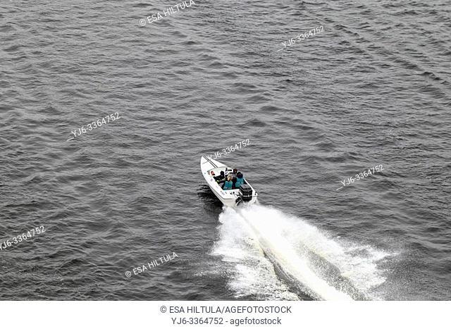 Small speed boat speeding along lake Saimaa, Lappeenranta Finland