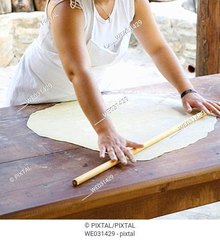 Fixing paste in Enagron traditional house, Axos village. Crete, Greece
