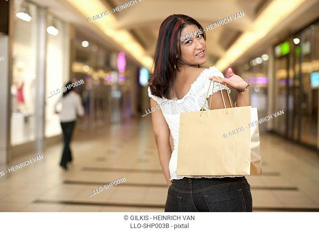 Young woman holding shopping bags, KwaZulu Natal Province, South Africa
