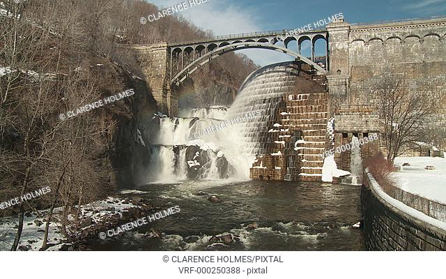Water flows over the spillway of the New Croton Dam on a warm winter day in Cortlandt, New York