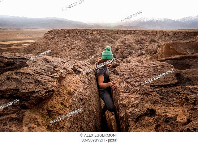 Climber stuck in offwidth crack, Sierra Nevada, Bishop, California, USA