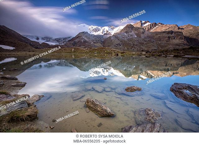 Sunrise reflections at Lake Rosole Forni Valley Valfurva Valtellina Lombardy Italy Europe