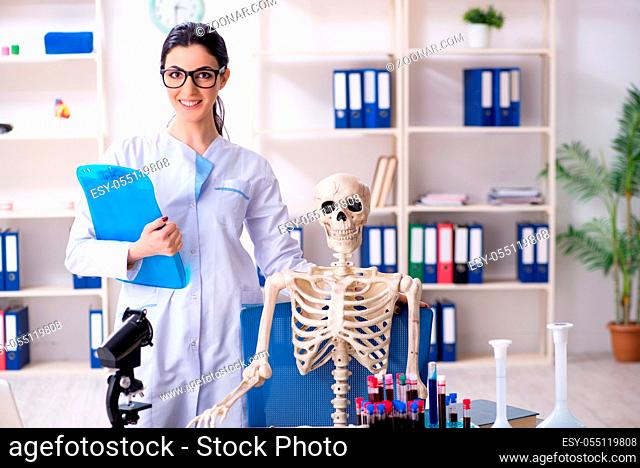 Young female archaeologist working in the lab