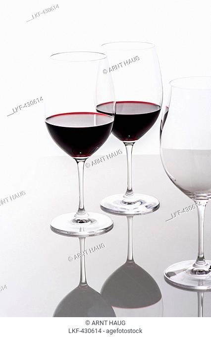 Two glasses of red wine and an empty glass, Hamburg, Northern Germany, Germany