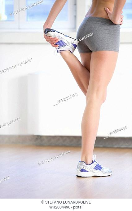 Close-up off fit female legs at gym