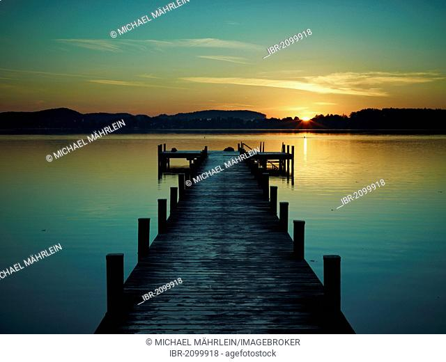 Jetty at Woerthsee Lake at sunrise, Bavaria, Germany, Europe