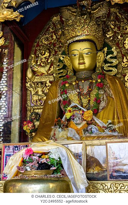 Nepal, Kathmandu, Swayambhunath. Buddha and Cash Donations
